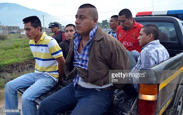 Six of seven alleged members of the drug gang Los Zetas who were arrested in Jalapa 100 km west Guatemala city remain on a truck on June 1 2012...