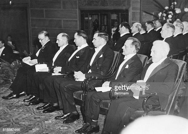 Six of seven Nobel Prize winners appear at the awards ceremony held in Stockholm, Sweden. Left to right: Sir John Cockroft and Ernest T.S. Walton,...