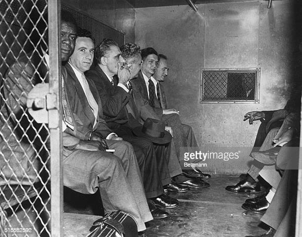 Six of the twelve Communists convicted of advocating the overthrow of the government being returned to their jail cells Pictured are Henry Winston...