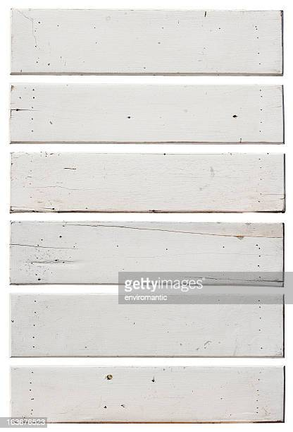 Six old white weathered wood boards.