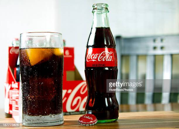six pack of 8oz coca cola with glass - soda bottle stock pictures, royalty-free photos & images