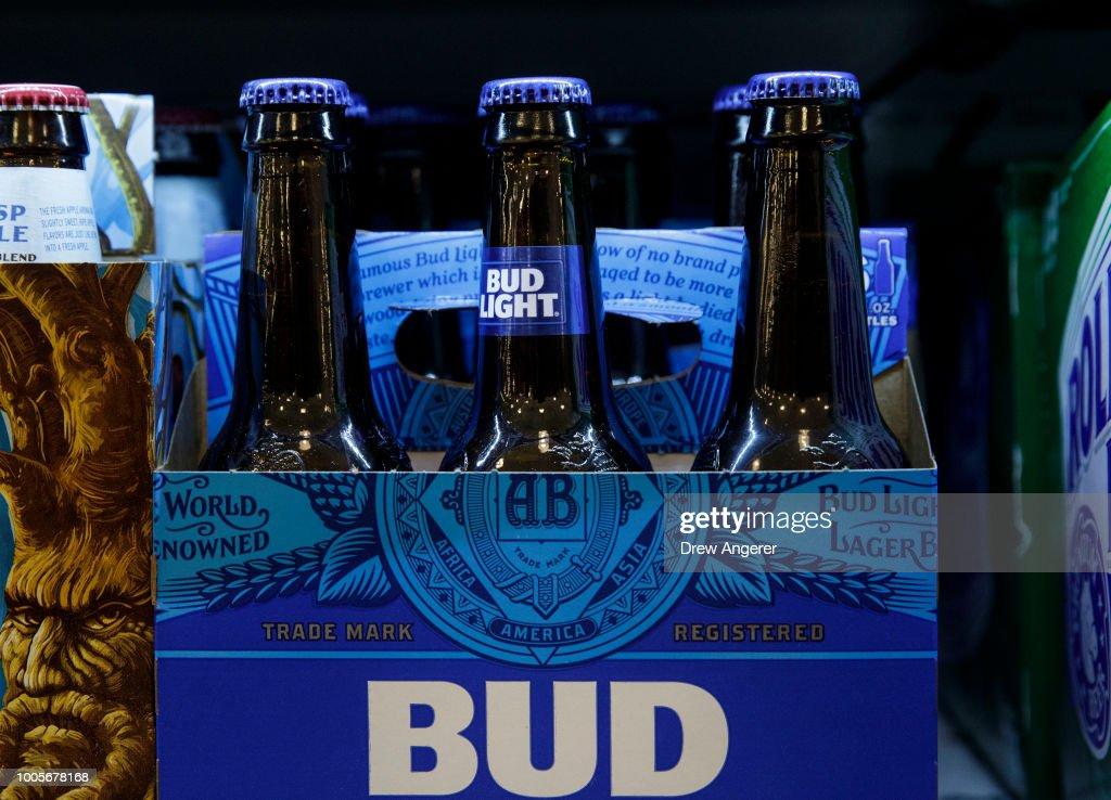 A six pack of Bud Light sits on a shelf for sale at a convenience