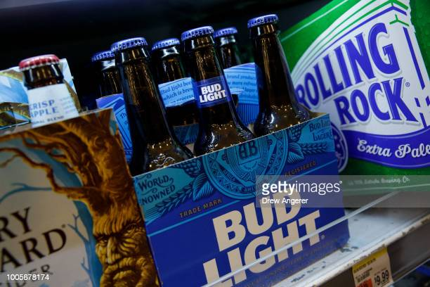 Six pack of Bud Light sits on a shelf for sale at a convenience store, July 26, 2018 in New York City. Anheuser-Busch InBev, the brewer behind...