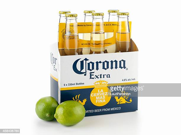 six pack of corona beer with limes - mexican beer stock pictures, royalty-free photos & images