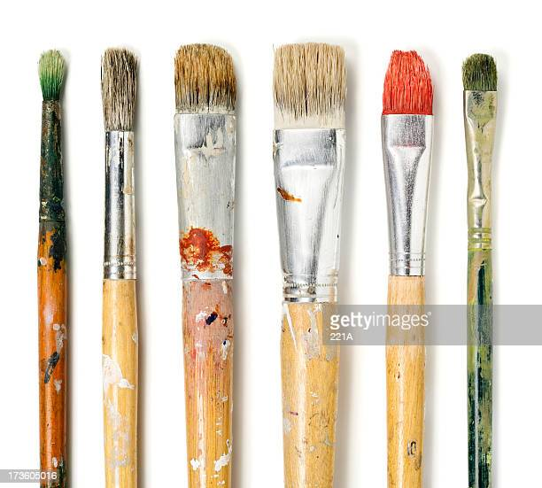 Six paintbrushes on white