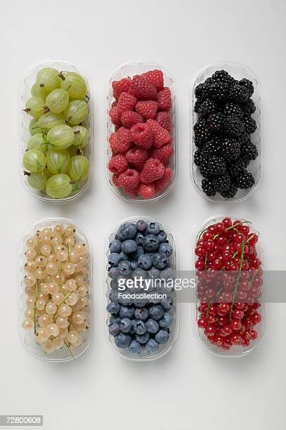 Six plastic punnets of different berries