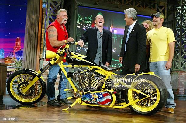 Six time Tour De France winner cyclist Lance Armstrong receives a custom built chopper from Paul Teutel Sr and Paul Teutel Jr on 'The Tonight Show...