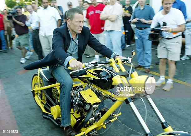 "Six time Tour De France winner, cyclist Lance Armstrong rides a custom built chopper gives to him by Paul Teutel Sr. And Paul Teutel Jr. On ""The..."
