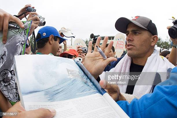 six times ASP world champion and current ASP ratings leader Kelly Slater of the USA is mobbed by fans November 7 2005 at Imbituba Santa Catarina...