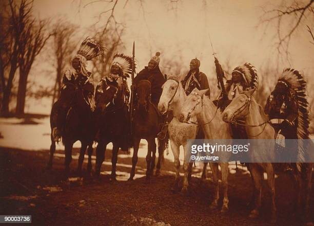 Six tribal leaders Little Plume Buckskin Charley Geronimo Quanah Parker Hollow Horn Bear and American Horse on horseback in ceremonial attire]