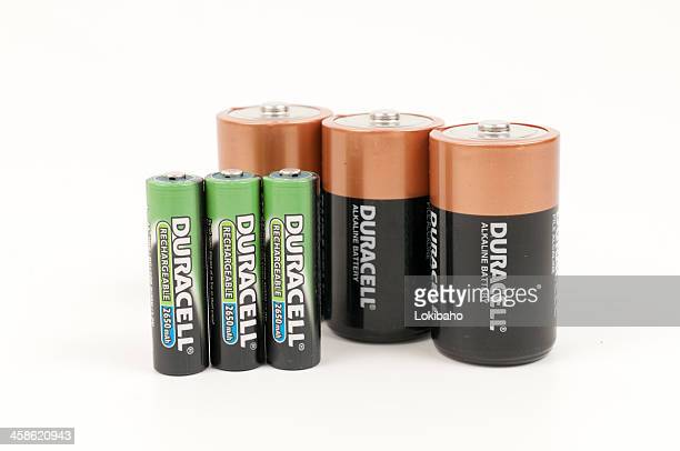 six upright duracel batteries, alkaline and rechargeable - duracell stock pictures, royalty-free photos & images