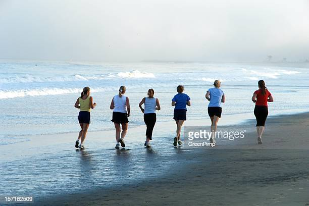 Six Women Exercise Morning Beach Run