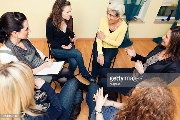 Six women in circle having a discussion