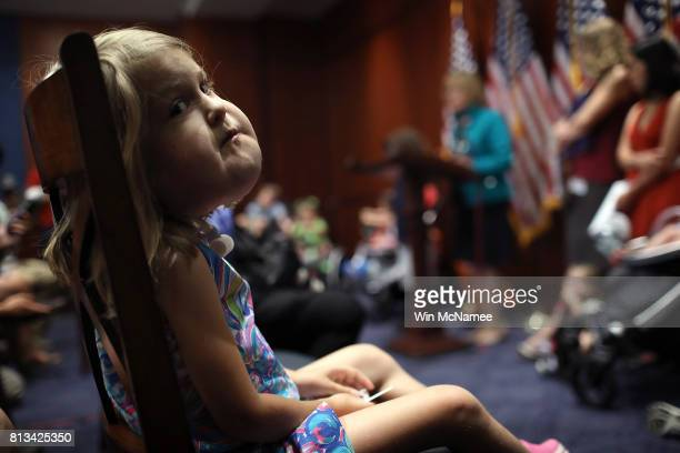 Six year old Addison Mosley of Silver Spring, Maryland, who has a rare condition called lymphatic malformation, listens as Democratic senators hold a...