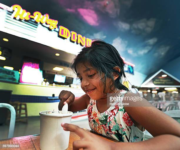 Six year old Anushka Talukdar from Swampscott Mass eats ice cream at the Hooksett Tolls Rest Area on the northbound side of Route 93 in Hooksett NH...