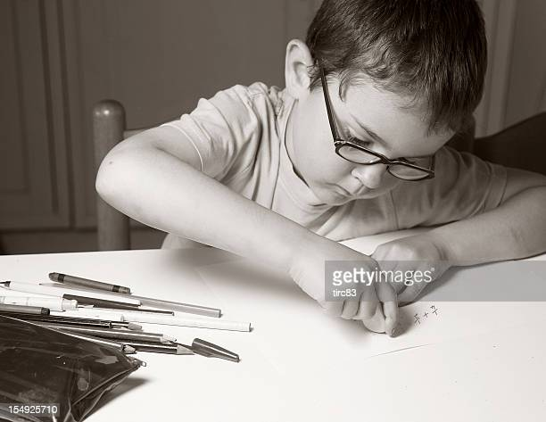 Six year old boy doing fractions homework