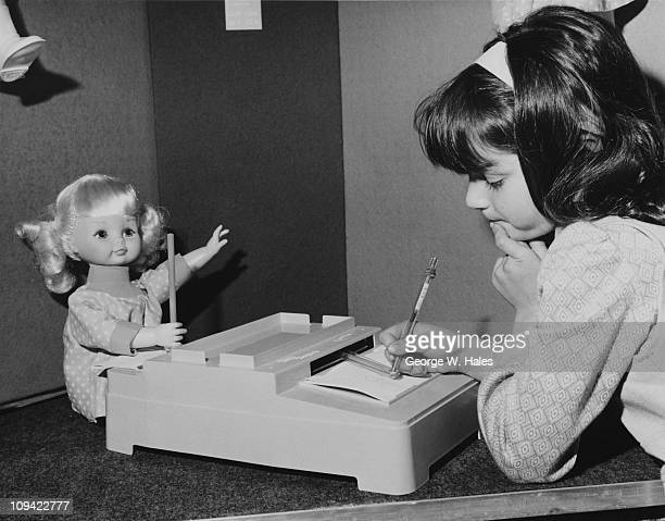Six year old Claudin Lebouitch playing with a Katie Kopycat toy from Palitoy at the London Toy Show at Grosvenor House 8th June 1971 The toy features...