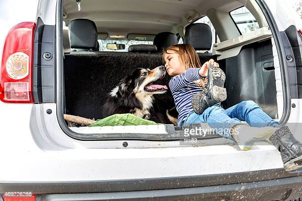 Six year old girl boot of car with her dog
