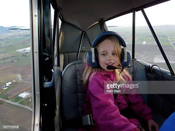 Six year old girl in small plane.