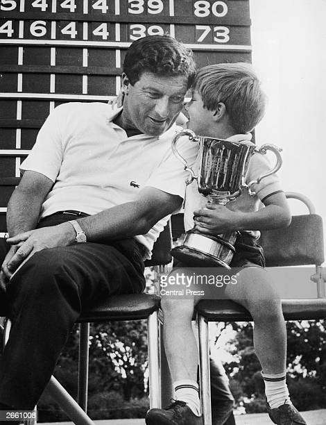 Six yearold Andrew Thomson seen here holding the Australian Open championship cup which his father golfer Peter Thomson had just received