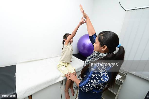 A six years old Anshika who has tested positive for AFP is undergoing her physiotherapy session at a local clinic on July 3 2015 in Bareilly India...