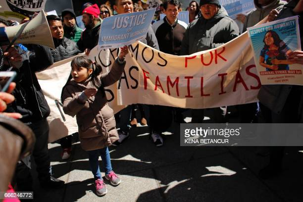 A six years old girl from El Salvador holds a placard during a rally around Trump Tower in support of immigrants workers on April 08 2017 in New York...