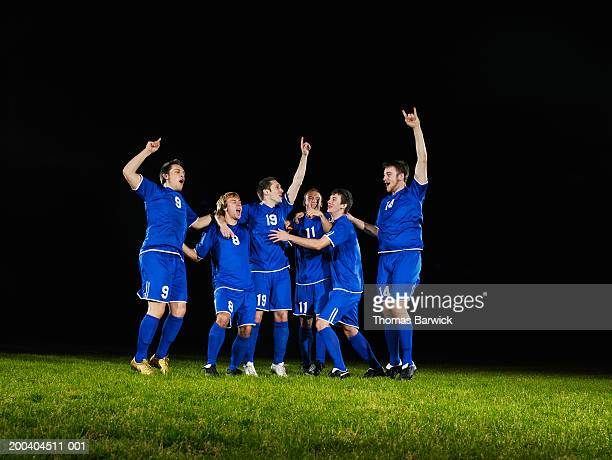 six young male soccer players cheering and yelling - football team stock pictures, royalty-free photos & images