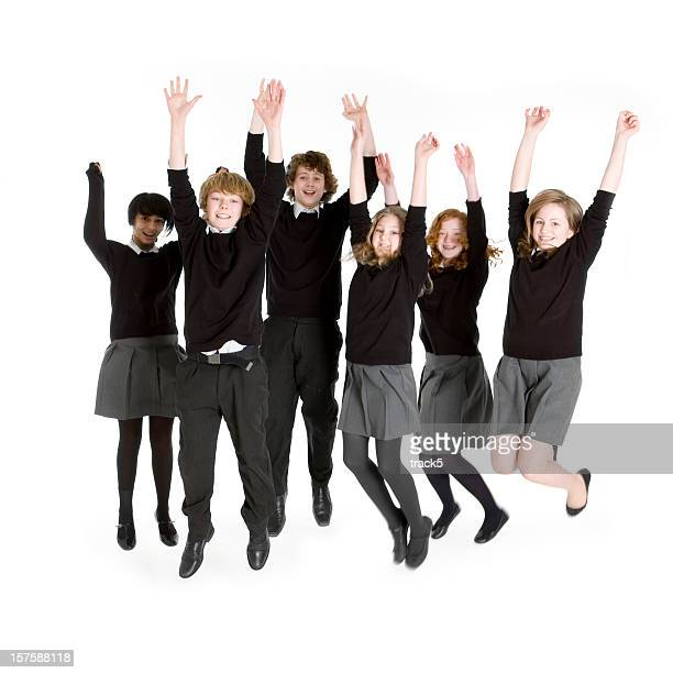 Six young teenage students jumping for joy