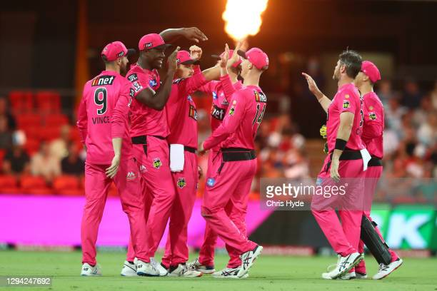 Sixeres celebrate after dismissing Alex Carey of the Strikers during the Big Bash League match between the Adelaide Strikers and the Sydney Sixers at...