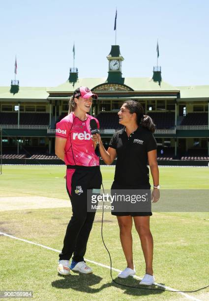 Sixers captain Ellyse Perry talks to cricketer and commentator Lisa Sthalekar after the coin toss during the Women's Big Bash League match between...
