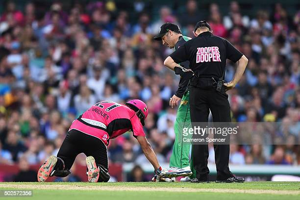 Sixers captain Moises Henriques injures himself during the Big Bash League match between the Sydney Sixers and the Melbourne Stars at Sydney Cricket...