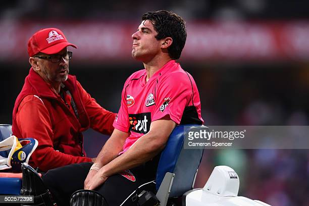 Sixers captain Moises Henriques leaves the field injured during the Big Bash League match between the Sydney Sixers and the Melbourne Stars at Sydney...