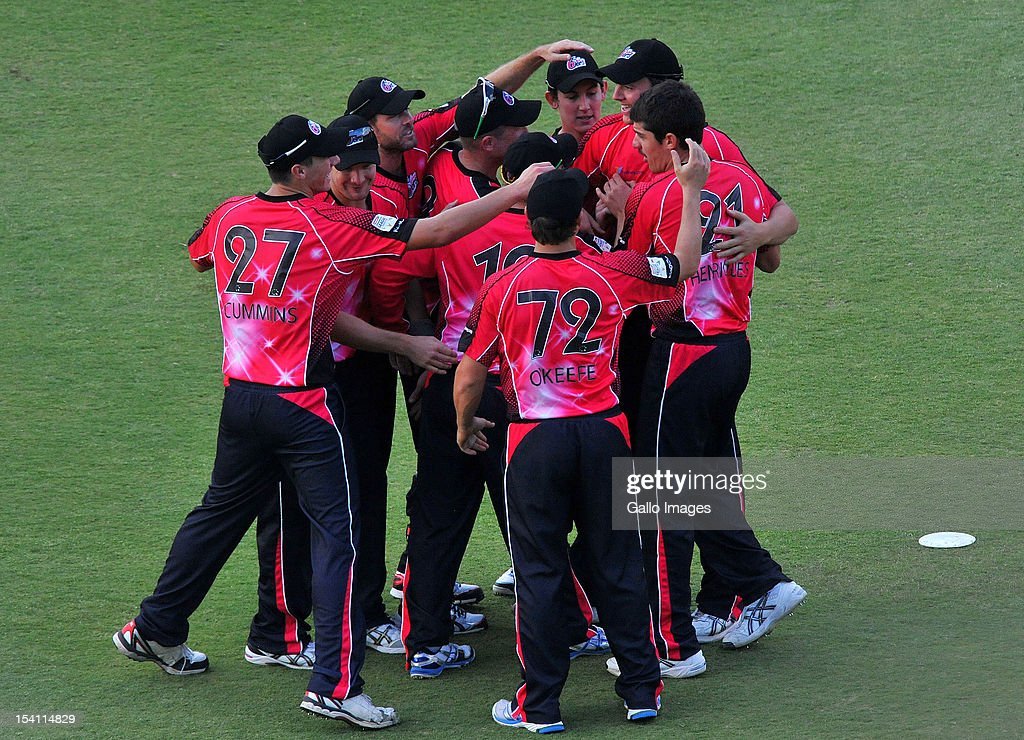 Sixers players celebrate the wicket of MS Dhoni for 8 runs during the Champions League Twenty20 match between Chennai Super Kings and Sydney Sixers at Bidvest Wanderers Stadium on October 14, 2012 in Johannesburg, South Africa.