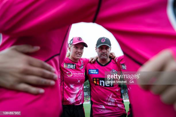 Sixers players huddle during the break before the final super over during the Women's Big Bash League Semi Final against the Melbourne Renegades on...