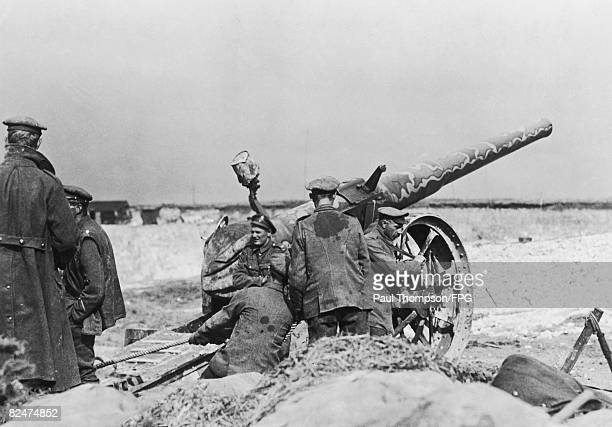 A sixinch naval gun operated by the British behind the Division Headquarters of the 27th American Division at Ronssoy in the Somme 30th September 1913