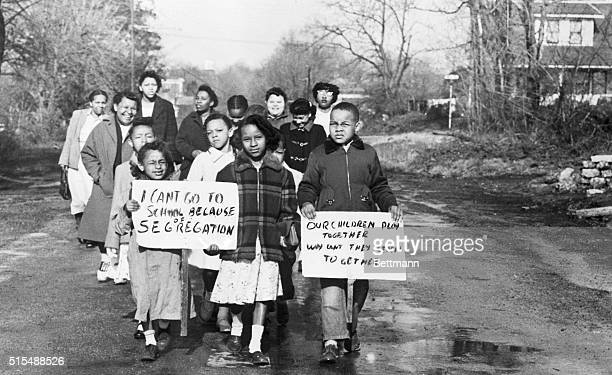 Sixteen Black children accompanied by 4 mothers carry signs demonstrating their feelings as they walk to Webster School in Hillsboro Ohio April 3...