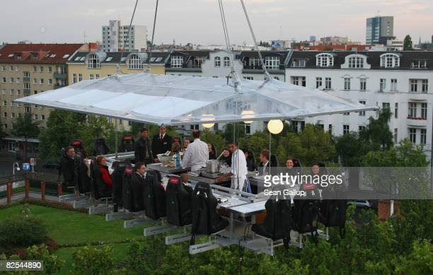 Sixteen guests partake in a fourcourse dinner at a table approximately 50 meters above the ground on August 25 2008 in Berlin Germany The event...