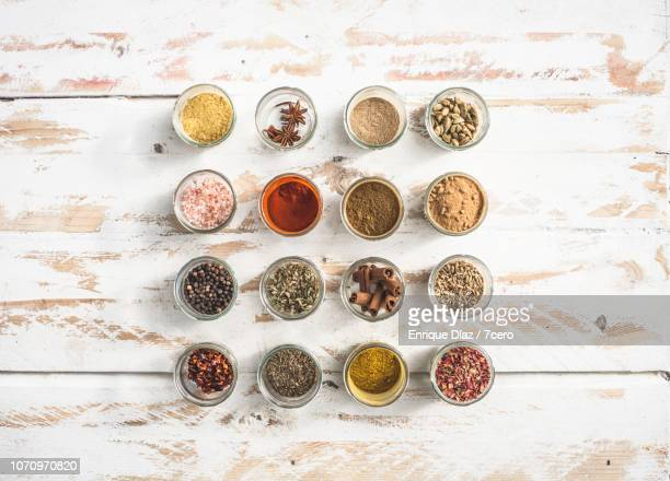 sixteen spice jars flat lay - season stock pictures, royalty-free photos & images