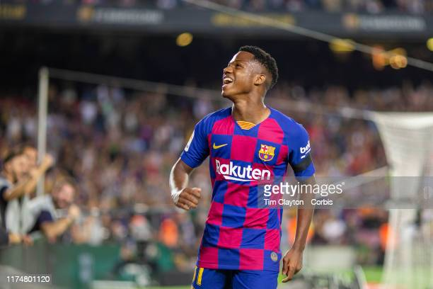 Sixteen year old Anssumane Fati of Barcelona celebrates after providing the assist for his sides second goal by Frenkie de Jong of Barcelona and...