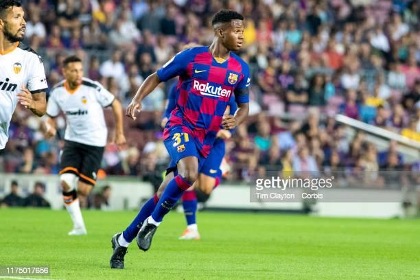 Sixteen year old Anssumane Fati of Barcelona in action during the Barcelona V Valencia La Liga regular season match at Estadio Camp Nou on September...