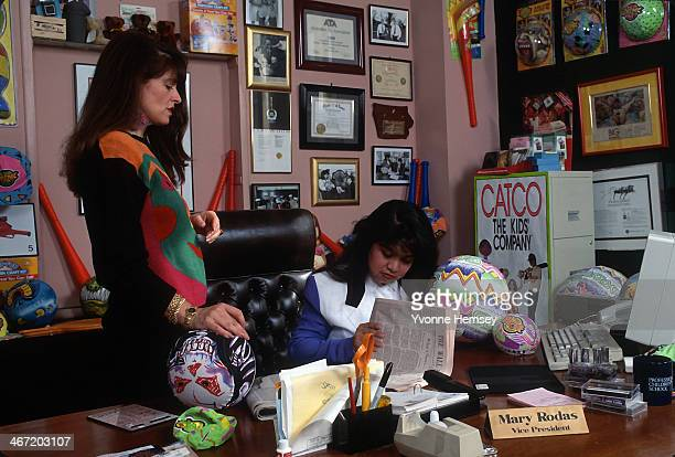 Sixteen year old toy executive Mary Rodas is photographed March 31 1992 reading a Wall Street Journal story with a coworker at her office at Catco...