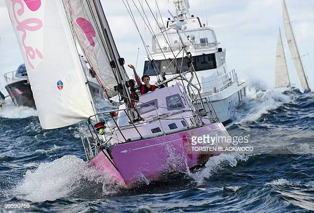 Sixteen yearold Australian roundtheworld sailor Jessica Watson waves to a flotilla of wellwishers as her yacht 'Ella's Pink Lady' crosses the...
