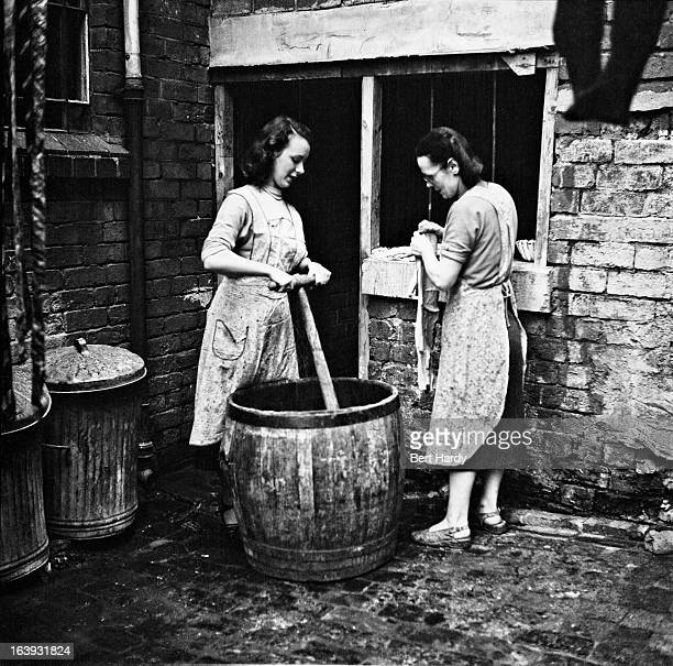Sixteen yearold hairdresser Betty Burden and her mother spend their Wednesday halfday off doing the family washing in a tub in the back yard of their...