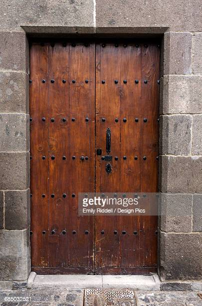 sixteenth century brown wooden door, with iron fastenings, set in stone doorway - 16th century style stock pictures, royalty-free photos & images