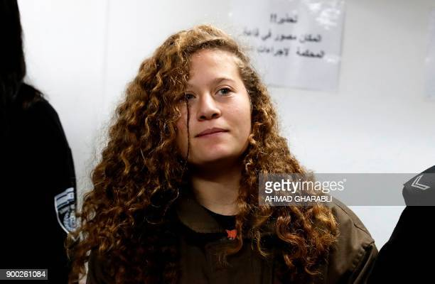 Sixteenyearold Ahed Tamimi stands for a hearing in the military court at Ofer military prison in the West Bank village of Betunia on January 1 2018...