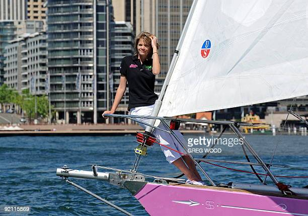 Sixteenyearold Australian sailor Jessica Watson sails her bright pink 1023metre yacht during a media photo opportunity on Sydney Harbour on October 7...