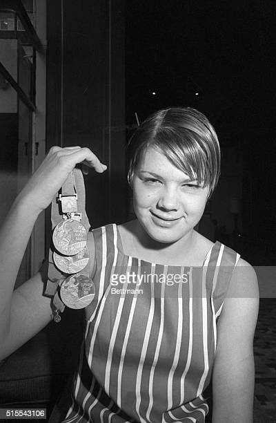 Sixteenyearold Debbie Meyer of Sacramento California the only swimmer ever to win three individual gold medals in the Olympic games poses October 25...