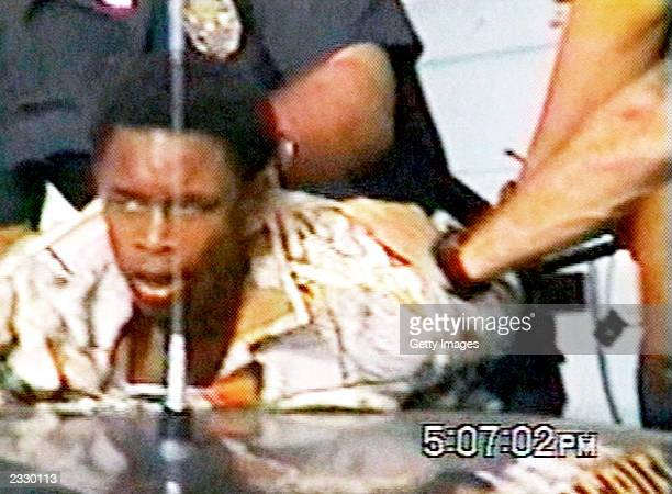 Sixteenyearold Donovan Jackson is shown in this image from an amateur video up during his arrest by police July 8 2002 in Inglewood California Jeremy...
