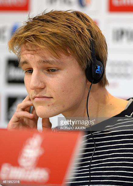 Sixteenyearold Norwegian midfielder Martin Oedegaard looks on as he gives a press conference during his official presentation at the Valdebebas...