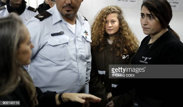 TOPSHOT Sixteenyearold Palestinian Ahed Tamimi a wellknown campaigner against Israel's occupation stands for a hearing in the Israeli military court...